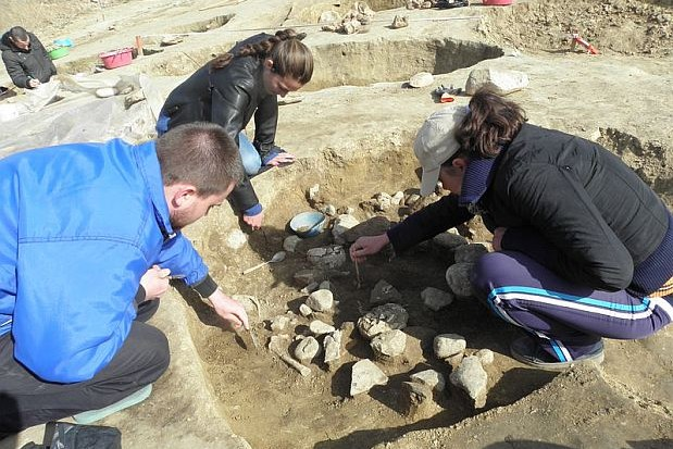 A third child skeleton has been found in this 6th century BC Ancient Thracian ritual pit which is believed to have been the site of an Ancient Thracian child sacrifice. It is found at the site of a 8,000-year-old Early Neolithic city near Bulgaria's Mursalevo. Photo: BGNES